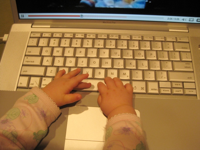 Chloe's fingers on the Mac keyboard