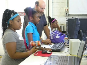 Volunteer and youth in the Fab Lab (U Illinois I-STEM photo)