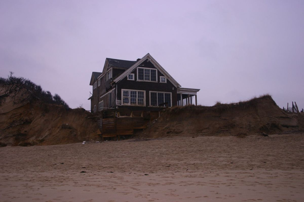 House partly over dune edge