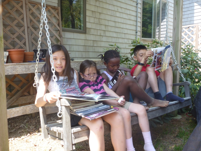 Sharing books and a swing