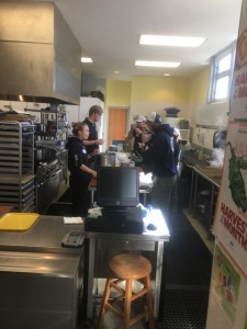 Americorps workers helping serve Mac's clam chowder
