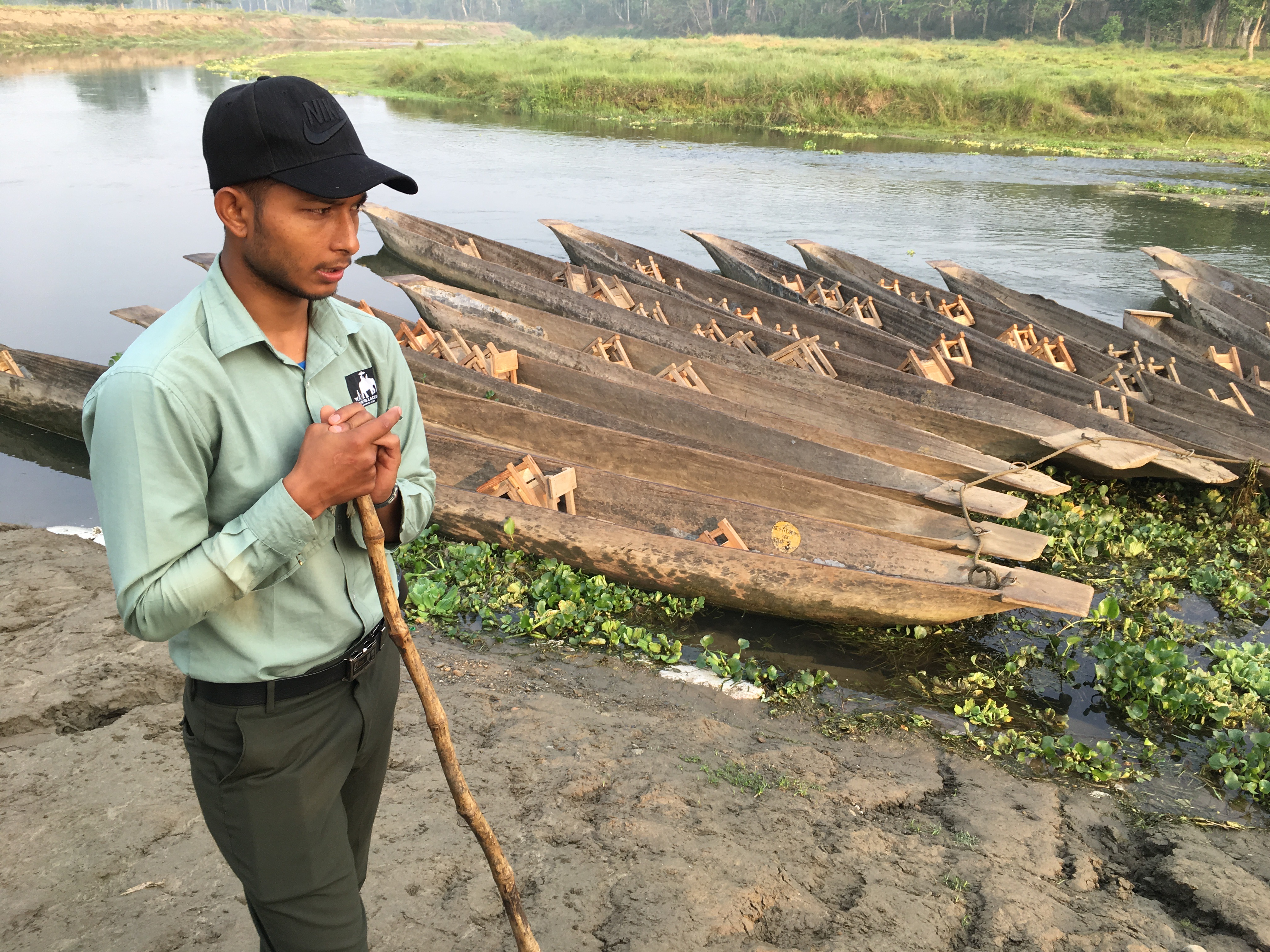 Our excellent guide, Suman, with doongas, on the Rapti River